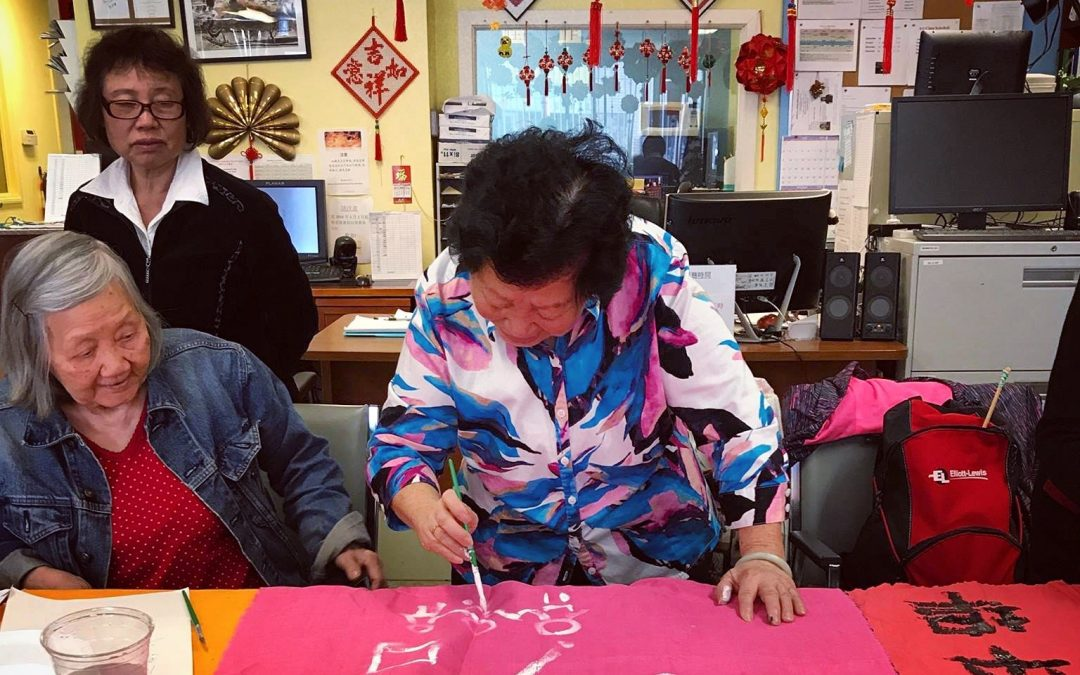 Banner making workshop with grandparents at On Lok Social Service Center for Seniors